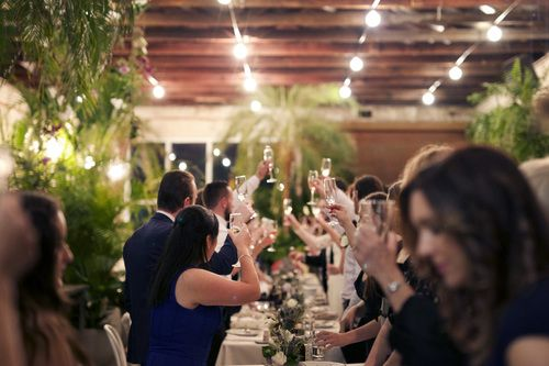 Stunning warehouse venue for a relaxed wedding at long banquet tables, Alice and Cal's wedding at Glasshaus Inside was an absolute dream