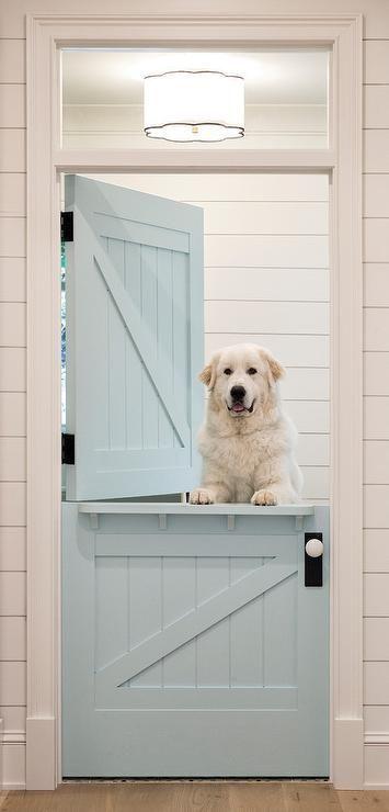 White shiplap frames a blue shiplap dutch door acc…