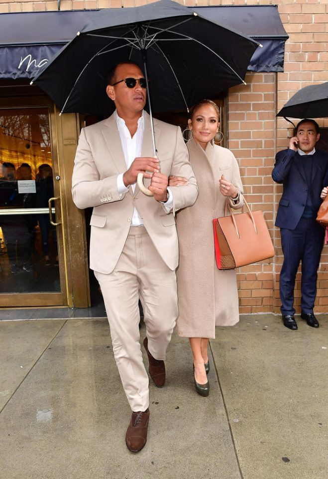 New couple Jennifer Lopez and Alex Rodriguez stepped out together in matching beige ensembles on March 31 in New York City. Lopez donned a Max Mara coat that she paired with a Christian Louboutin studded tote, while Rodriguez sported a cream suit. (Photo: Getty Images)