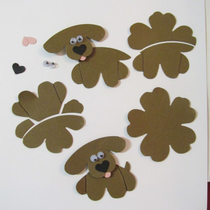 """I created these little pups for the Stampinup #punchitup challenge. These are """"Pansy Punch Pups. I used paper snips, the xtra large oval and a post-it note to create the shapes needed."""