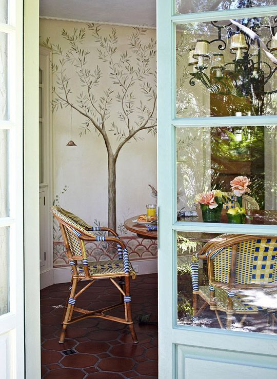 The wall mural of the breakfast room can be spied from the French doors. - Traditional Home ® / Photo: Werner Straube / Design: Madeline Stuart