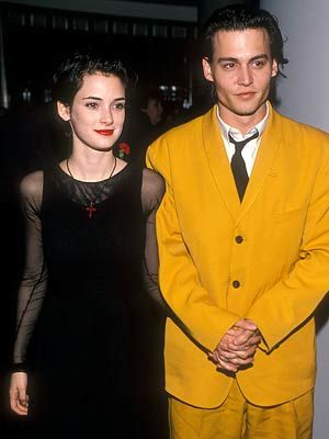 Winona Rider & Johnny Depp- colors were more available for men's suits and the boxer shoulders. Winona wears all black with a bit of the sheer trend that sprung up