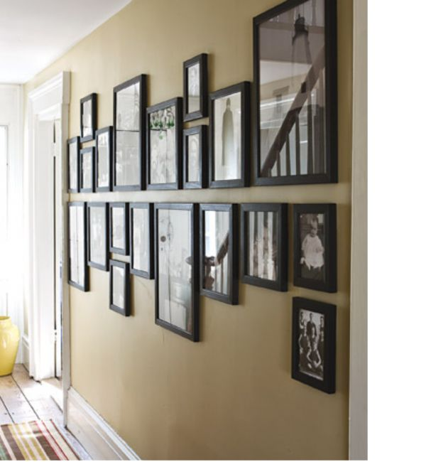 Mark a horizontal midline on the wall, and hang all pictures above and below it.