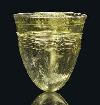 A Merovingian olive green glass beaker, circa 5th-6th century AD