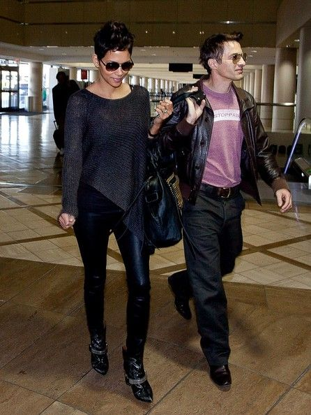 Halle Berry Leggings  Halle Berry's leather leggings gave the actress a rocker edge especially when paired with a loose blouse.   Halle Berry Loose Blouse  Halle Berry's loose asymmetrical blouse was comfy and casual for her flight at LAX.