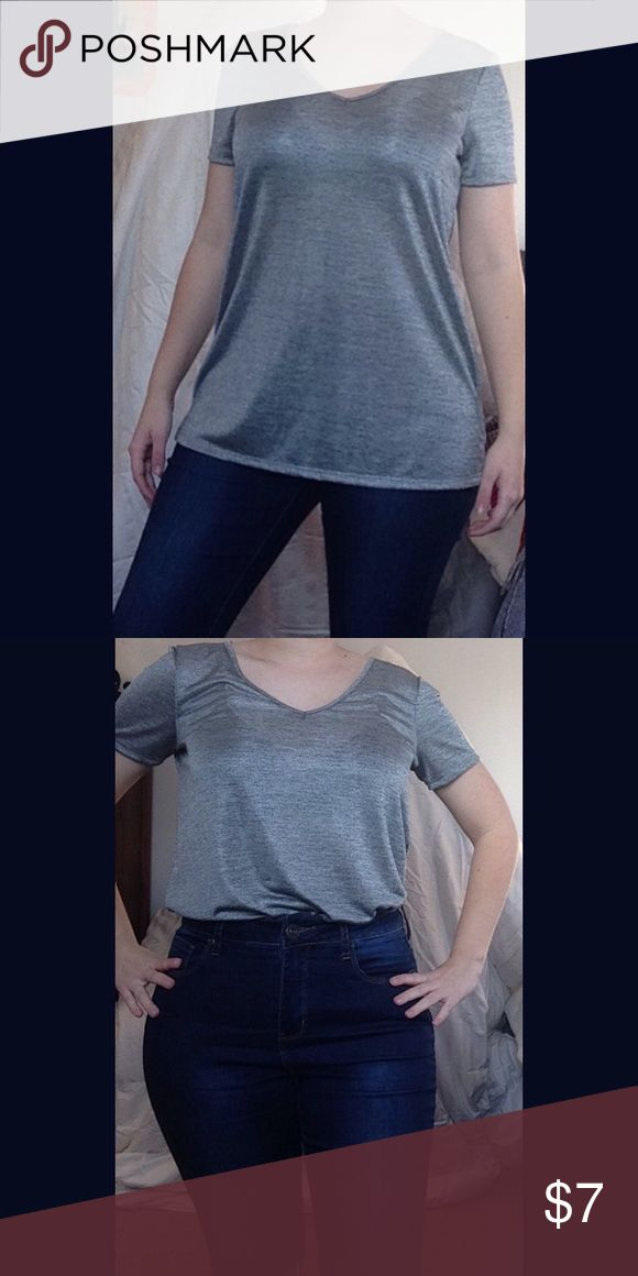 Silver Shimmer Tee Silver metallic Tee w/ a soft silky feel to it. 97% polyester / 3% spandex like new condition Last photo shows one option for accessorizing. One ❤️ Clothing Los Angeles Tops Tees - Short Sleeve