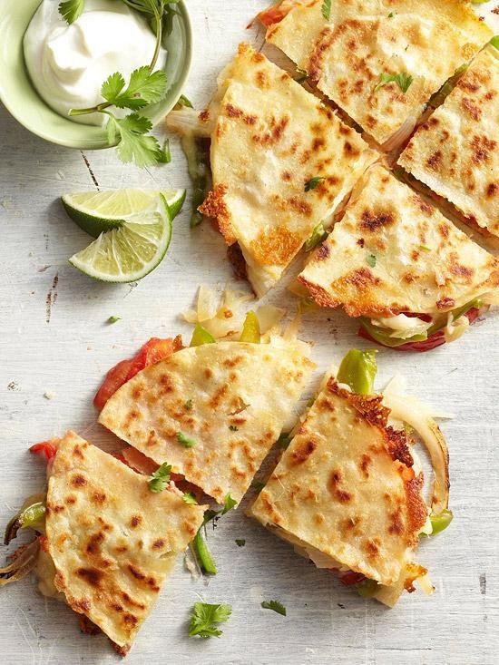 Fajita-Style Quesadillas / BHG   meals on a budget! stuff 2 corn tortillas with your choice of fajita filling spray non stick cooking spray onto flat griddle. Cook at med heat and until golden and crunchy on both sides. Serve with sour cream.