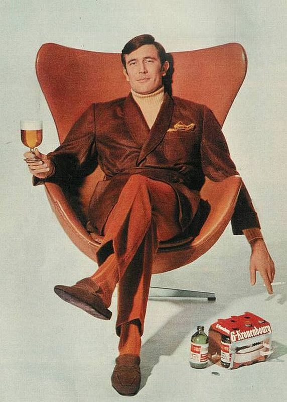 George Lazenby sitting in Arne Jacobsen's Egg chair having a Kronenbourg and a smoke. He starred as James Bond in the 1969 film 'On Her Majesty's Secret Service'.
