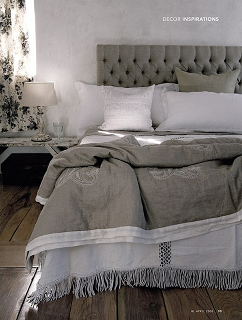 grey bedroom Kings size bed that has a split matt. that is remote