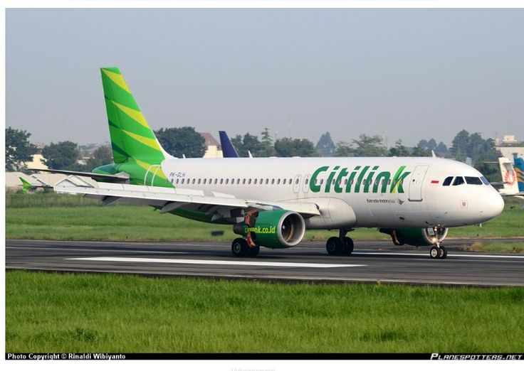 INDONESIAN OFFERING CITILINK,Garuda Indonesia's Low Cost Airline much involved in Shuttle services between Indonesian Cities. See variation in colours from Garuda's mainline operation.  Airbus A320-200 PX-GLH at Medan-Soewondo AFB. Photo by Rinaldo Wibiyanti