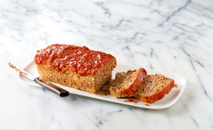A delicious meatloaf, this recipe uses ground beef, Campbell's® Tomato Basil & Oregano soup, Parmesan & bread crumbs.