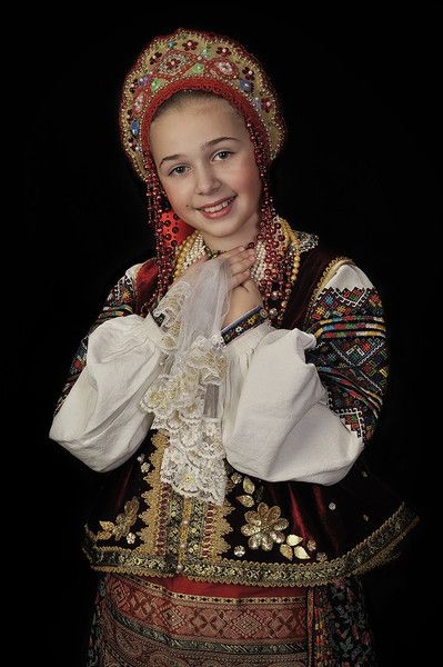 A smiling girl is wearing the Russian national costume and a kokoshnik. #cute #kids #Russian #folk