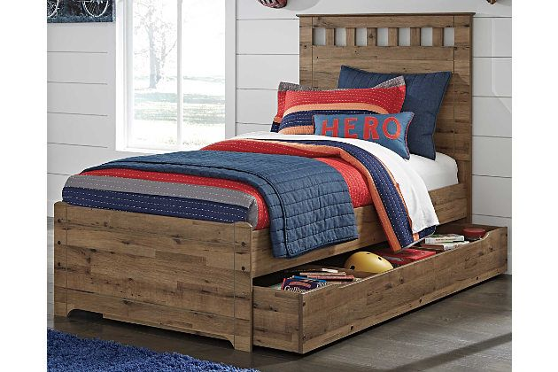 Does your little one love exploring the great outdoors? Bring the outside in with the Brobern twin panel bed with trundle storage. Its light brown finish over replicated oak grain is naturally appealing. Top of headboard has cut-out design to let the wall color peek through. Use the trundle for storage or as a guest bed for your little one's best buddy. With a lodge feel, this bed is splendidly rustic. Mattress available, sold separately.
