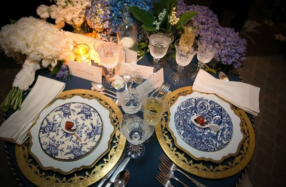 Custom linens and elegant china, with a blue and white motif, make for a simple but striking design  #EventProfs