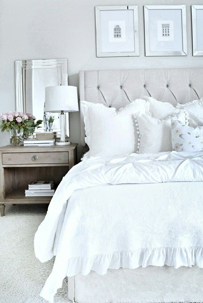 Silver toned accents and cream are a serene combination in the bedroom.