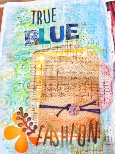 Recycled magazine for diecut alphabets and leftover scraps.  Brayer rolled acrylic paint background and texture paste.