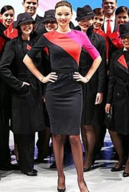Qantas uniform modelled by Miranda Kerr. The real crew haa issues with the uniform being uncomfortable. Ha