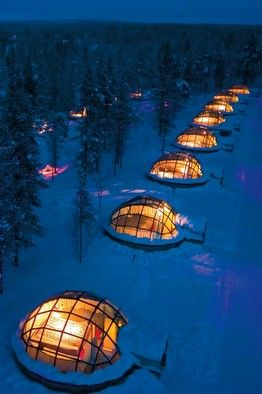 Renting a glass igloo in Finland to sleep under the northern lights. This would be incredible.   Yes please.