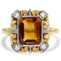 Utterly unique, this 14K white gold ring Retro ring features a citrine cabochon lofted in filigree setting with 14K rose and 14K yellow gold floral accents.
