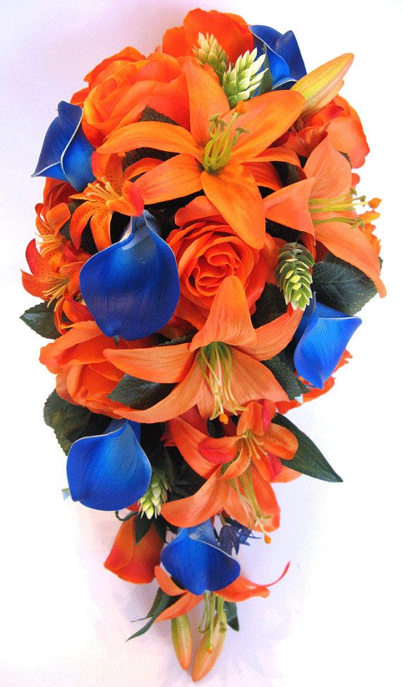 ~~~ US FREE SHIPPING for a limited time ~~~ If You Need Different Quantities, Different Colors or Matching Decoration Items Please Contact Us or a Custom Price Quote. This listing is for a 17 piece package including the following items: 1 Brides Cascade bouquet (9 wide by 16 long) made with Orange Lilies, Orange open roses and rosebuds, Royal blue Real touch Calla Lilies, small Orange Lilies, few green Hops and green leaves.The handle is wrapped in Royal blue Satin and decorated with Royal…