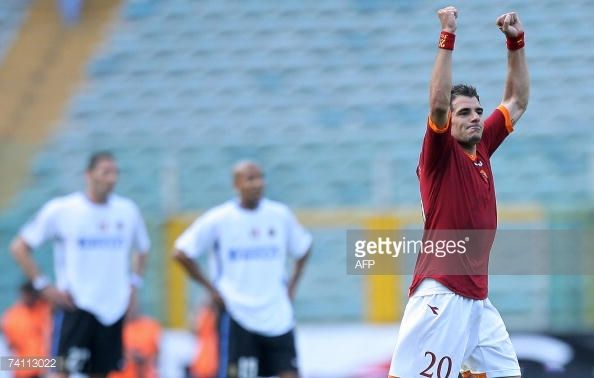Roma's Simone Perrotta jubilates after scoring against Inter Milan during their Coppa Italia first leg final football match at Rome's Olympic Stadium...