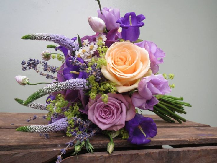 Peach, lilac and purple hand tied maids bouquet....