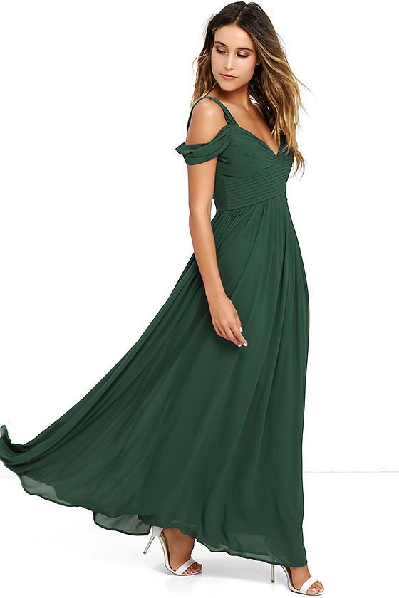 You'll be the hit of any dance floor in the Make Me Move Forest Green Maxi Dress! Double shoulder straps lead into a gathered surplice bodice with a sweetheart neckline. Pleated empire waist flows into an elegant woven maxi skirt. Hidden back zipper with clasp.
