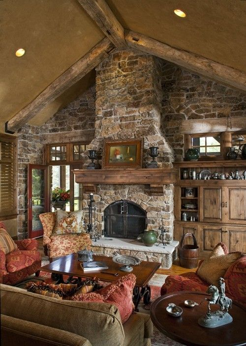 love the stone, the wood work, and the exposed beams on the ceiling. I need to live in the forest!