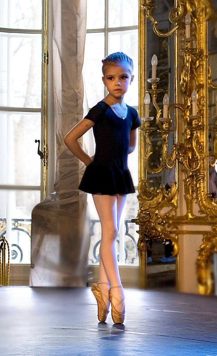 She is really really young for pointe, but I've gotta give it to her, she has beautiful lines and feet! Poor kid though:(