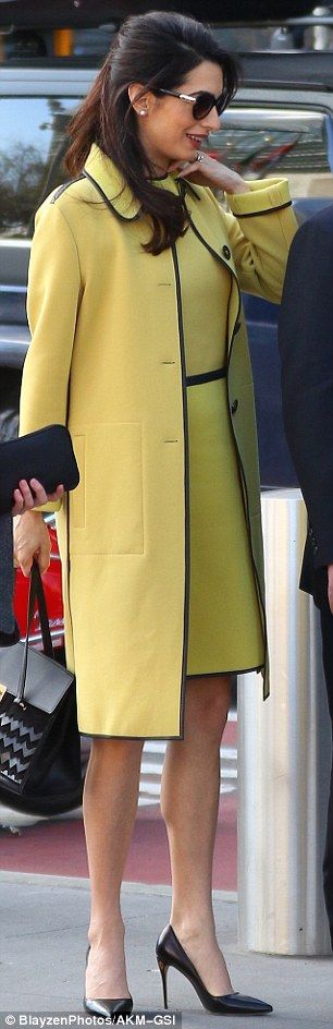 With her yellow dress complete with black trim, Amal Clooney cut a bright and beautiful figure as she left her New York hotel on Thursday.