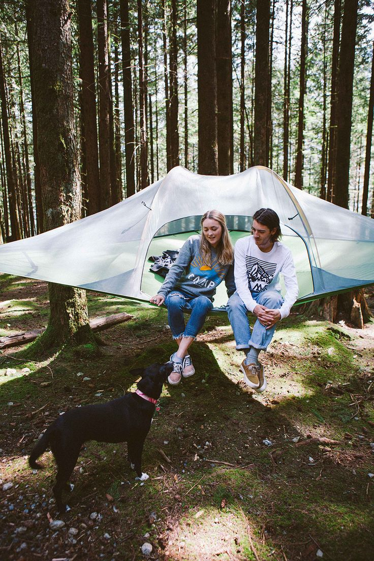 Her camping outfit: Hasta La Vista Crewneck Sweatshirt in tri grey. His camping outfit: Heritage Logo Long Sleeve Shirt in white fleck.
