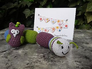 Containers (Kindersurprise) filled with Rice, lentils or anythings that makes a nice sound (tiny bells, marbles, ….) Be carefull to make very secure knots inside the egg so that Baby cannot s...