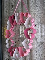 I found this valentine's wreath while searching for an easy child's valentine craft.  It's on Sarahsworld blog.  I just think it's a very eye-catching, fun wreath.
