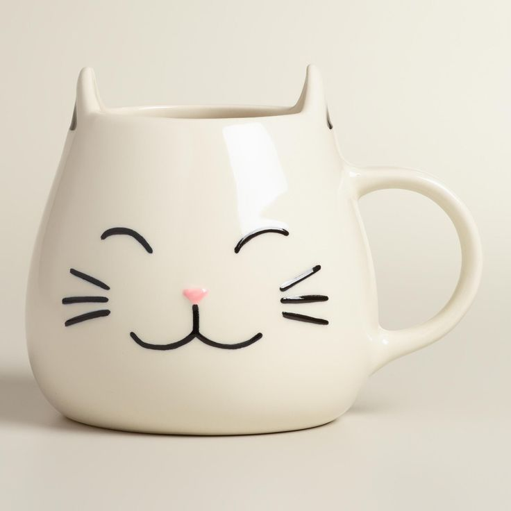 The perfect gift for animal lovers, our exclusive stoneware coffee mug looks like a happy cat with perky raised ears, a pink nose and adorable black whiskers. >> #WorldMarket Holiday Gift Giving Ideas