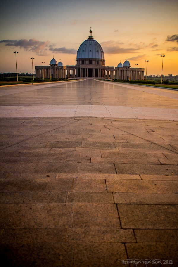 IVORY COST! Visit the Basilique Notre-Dame de la Paix in Yamoussoukro, Ivory Coast that is the biggest christian monument in the world. Its dome is even larger than the one on top of St Peter's cathedral in Rome. #IvoryCoast