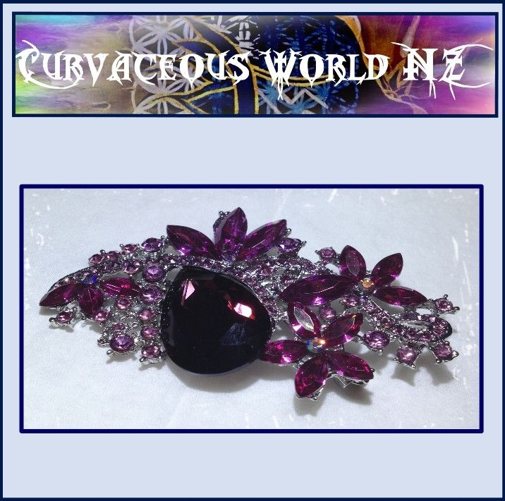 Rhinestone Purple Flower Silver Oval Broach for just $35.00.  ORDER HERE....... https://goo.gl/uBvzHA   Women's Large Flower Rhinestone Silver Broach comes in Blue (Gold), Cerise (Silver), Clear (Silver), Purple (silver) and Green (gold).   Measurements. Length 8cm by 4.5cm. #silver #Size9 #CoboltBlue #ChiffonCoralTop #TearDropEarrings #CurvaceousWorldNZLtd #SilverRing #GoldPlated #EmeraldEarrings #rhinestone #summertops #lovemybroaches #BrideJewellery #BohemianTop #ChiffonCoralBlouse