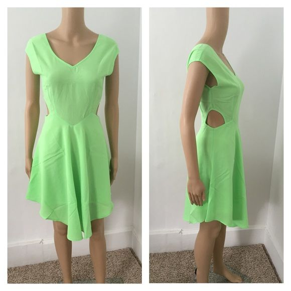 Large NWT light green dress ****PRICE FIRM NO TRADES****  This cap sleeve V-neck dress features a V-shape hemline with waist cutout accent. Low V-back design with concealed back zipper closure.  Item is new with tags and in the package   Color: light green   ****PRICE FIRM NO TRADES**** ****PRICE FIRM NO TRADES**** Dresses