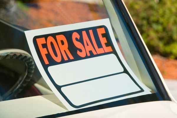 When you buy or sell a used car, make sure you file all the paperwork and close the deal properly.