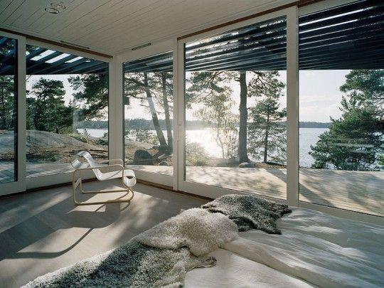 luxurious living room in Modern Mansion Passing as Cabin in the Woods-Archipelago House in Stockholm by Tham & Videgård Arkitekter Homesthetics