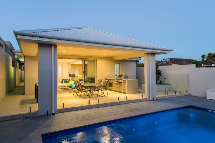 Outdoor alfresco, swimming pool, and cabana areas at the rear of the home.