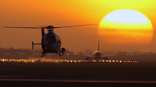 High-speed-chase in progress, lol !               PH-PXF Eurocopter EC135 KLPD landing at sunset @ EHAM Schiphol by nustyR AirTeamImages