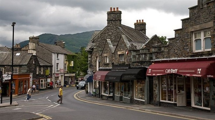 The main road (Rydal Rd) through Ambleside in the Lake District, Cumbria, England. [ Photo by DAVID ILIFF / CC BY-SA 3.0 ] Ambleside is a town in Cumbria, in North West England. Historically within the county of Westmorland, it is situated at the head of Windermere, England's largest lake. The town is within the Lake District National Park. http://www.flexijourney.com/blog/66-beautiful-small-cities-towns-in-europe/