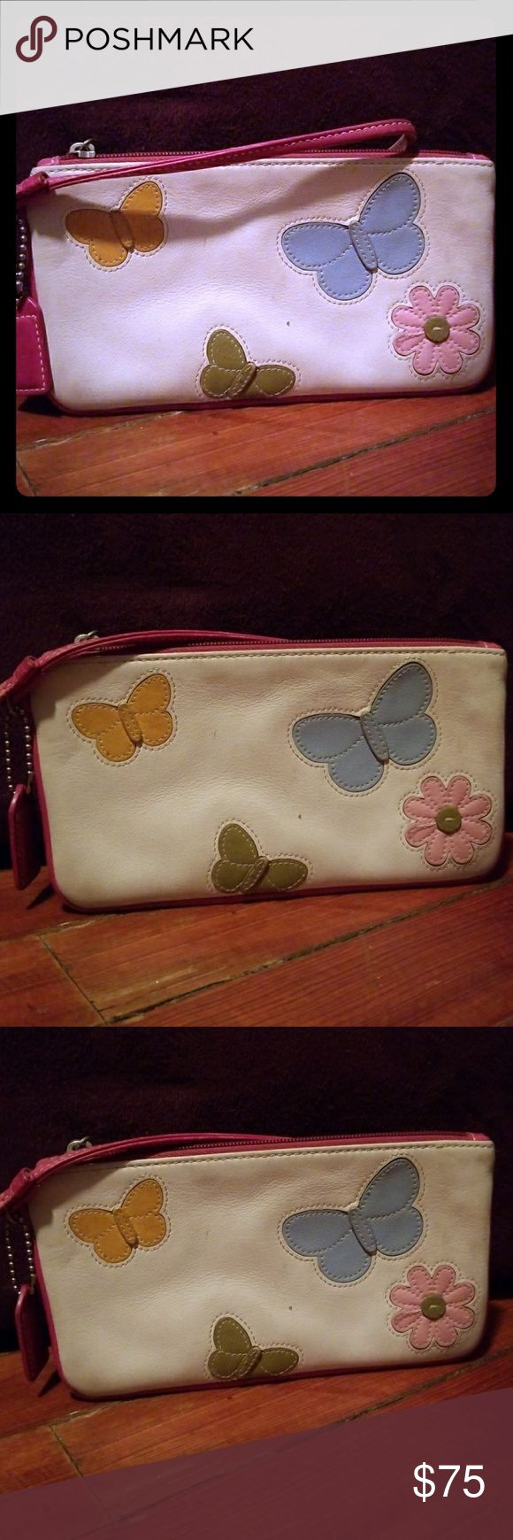 Butterfly Coach wristlet White leather Coach wristlet with butterflies, each butterfly a different color. Colors blue, green, yellow and pink. Coach Bags Clutches & Wristlets