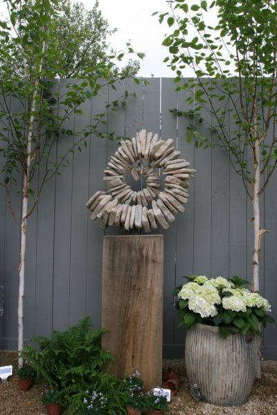 Garden ammonite..hm... wonder if I could do something like this with a glue gun...?