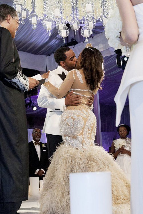 Kandi Burruss and Todd Tucker seal wedding vows with a kiss.  -- (Photo by: Wilford Harewood/Bravo) #RHoA