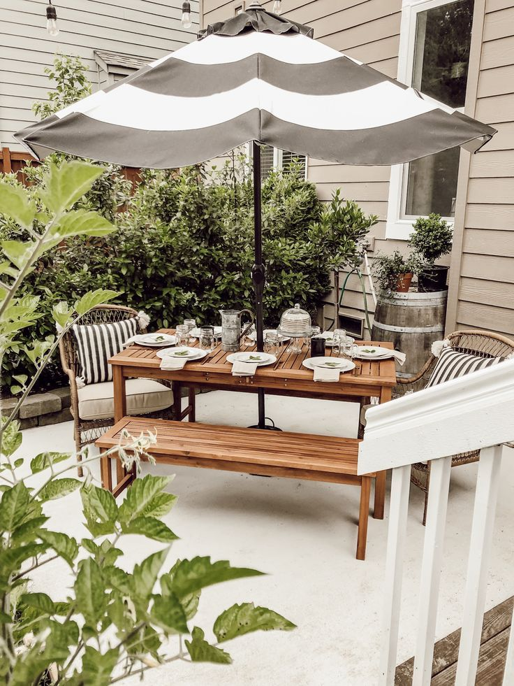A Neutral Cottage Farmhouse Style Patio Wood Outdoor Dining Table