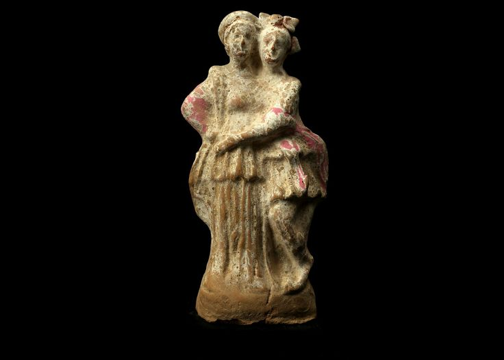 Tanagra figurine Greek terracotta statuette, Canosa, 3rd century B.C. Tanagra figurine, Greek Canosa terracotta figure, showing two female figures embracing, both wearing a long chiton and himation, with remains of pink pigment, 16 cm high. Private collection