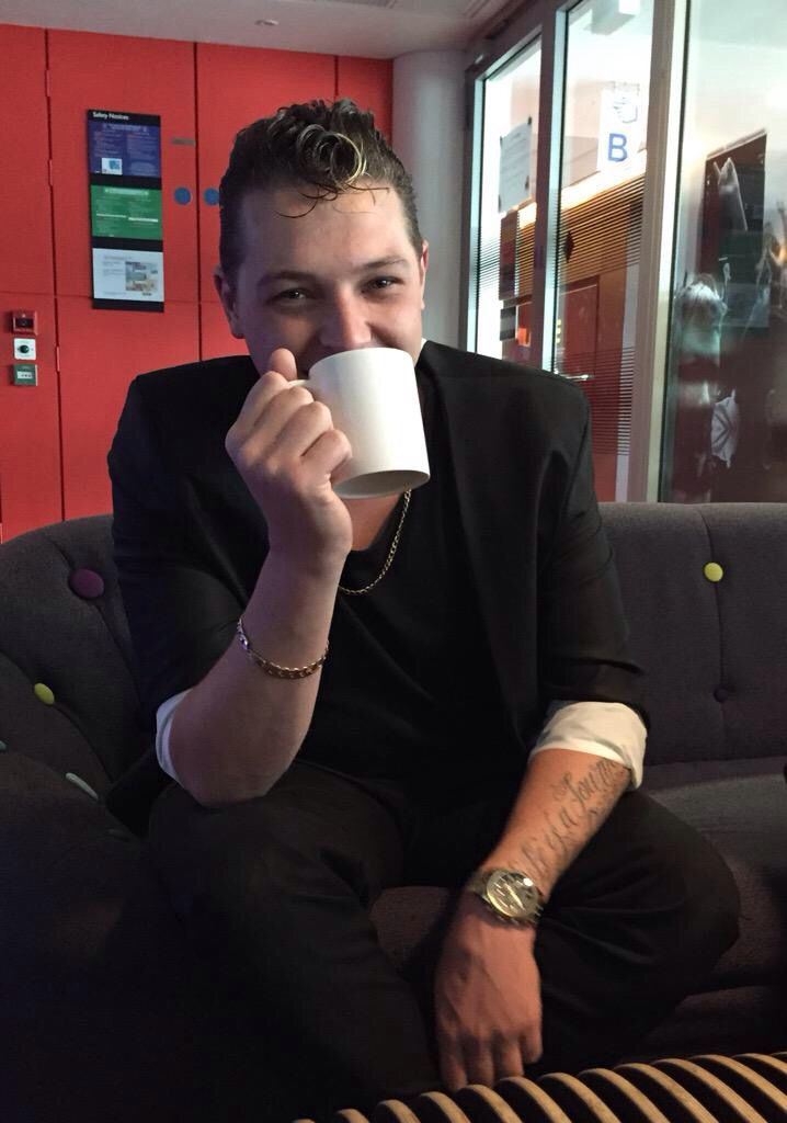 John Newman having a cup of tea