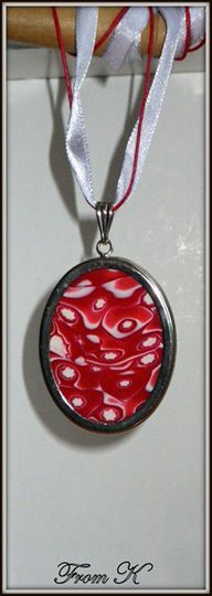 Oval Medallion. Beautiful and unique. Made of polymer clay, handmade by me, using the mokume cane technique with many layers of transitioning palettes. After choosing the best design I embedded it in a silver plated finding. The polymer clay is finished by sanding, polishing and varnished to a soft shine. About 3,5x5 cm big. Finished with 41cm long ribbon and cotton cord with a lobster claw clasp. 15.00 Ron