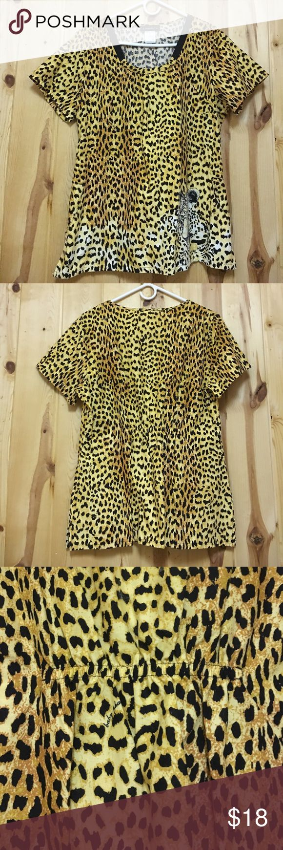 Baby Phat Scrub Top Large NWOT Great Price Baby Phat Scrub Top Large NWOT Top has 2 Front Pockets and Elastic Waist in back Has Tiger on left pocket Beautiful Scrub Top New Price never lower Thanks so much for stopping Baby Phat Tops